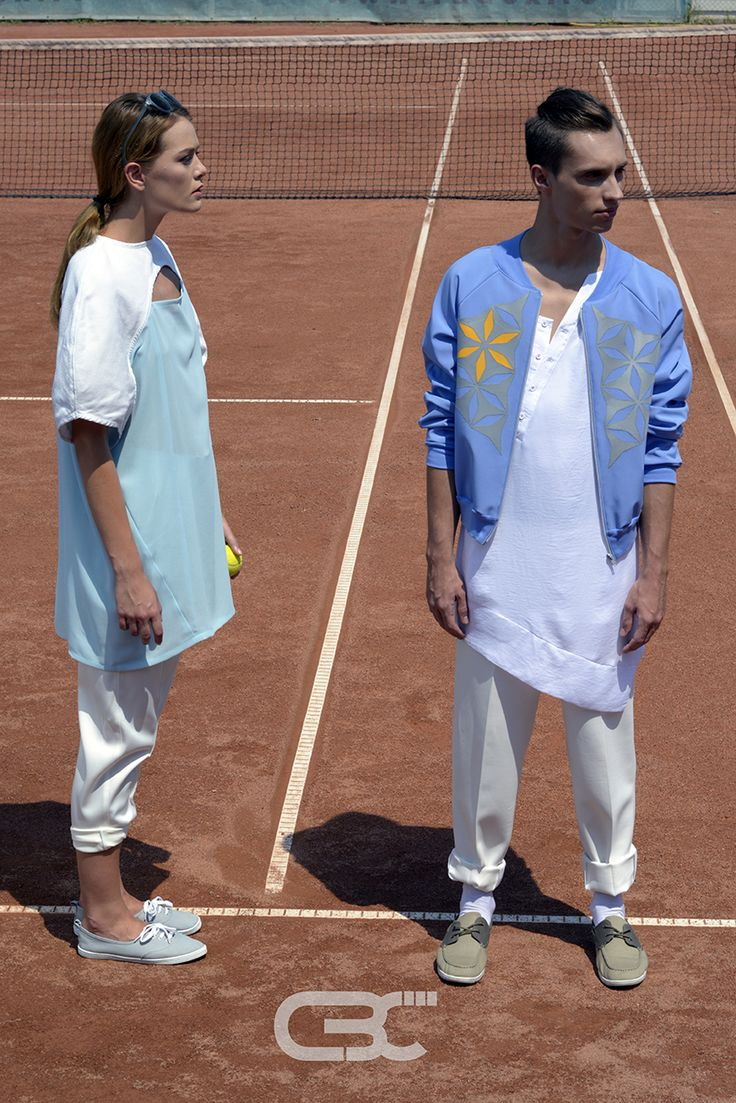 Lookbook: Her: White and teal dress, whitepants. Him: Blue bomber jacket, white long shirt, white pants. Tennis court, sport, sportswear, fitness, trends, unisex, campaign photos. Order via facebook, pm or e-mail.