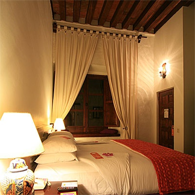 A room with high beamed ceilings in a centuries old former convent.