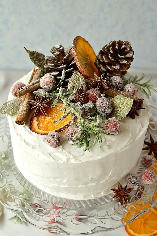 Gingery Christmas Fruit Cake topped with marzipan, royal icing, sugared cranberries, rosemary, bay leaves, dried orange slices, pine cones, and whole spices - Domestic Gothess