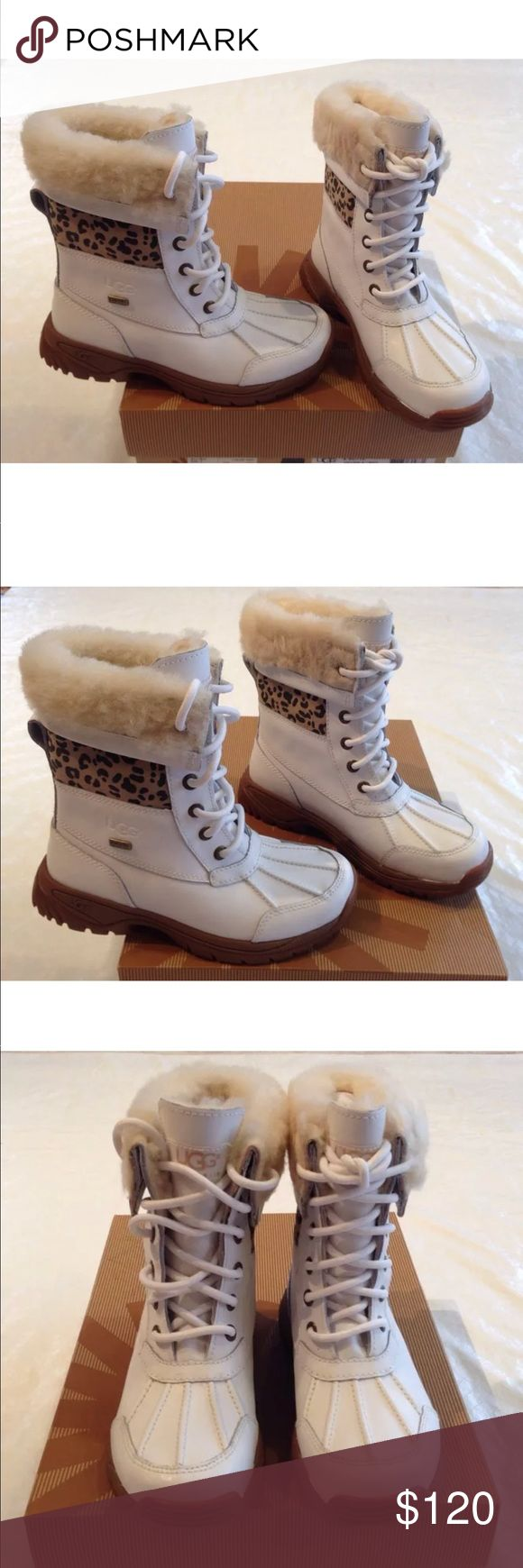 """UGG Australia**White Fur-lined Boots**US 1**$170 UGG Australia- K Butte. Style #1001936 K/ WHT. White leather fur- lined lace up Uggs. Beautiful and very stylish for your little girl, while she will be safe with the thick rubber sole, and warm with the fur lined boots. Boots are waterproof.  Boots are made with """"event"""" waterproof fabric. Great for -20 degrees Celsius's, says on the box. Vibram rubber soles, which are the best soles!!! USA 1; UK 13; EU 31; JAPAN 190 Retails for $190 + Tax…"""