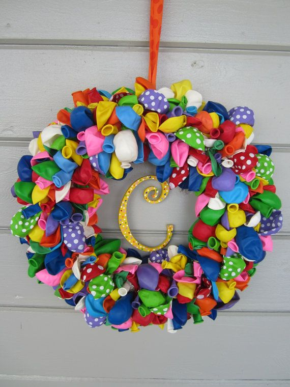 What a great way to add to that special day! This balloon wreath is a 14 straw wreath with multi-colored balloons and polka dot balloons attached