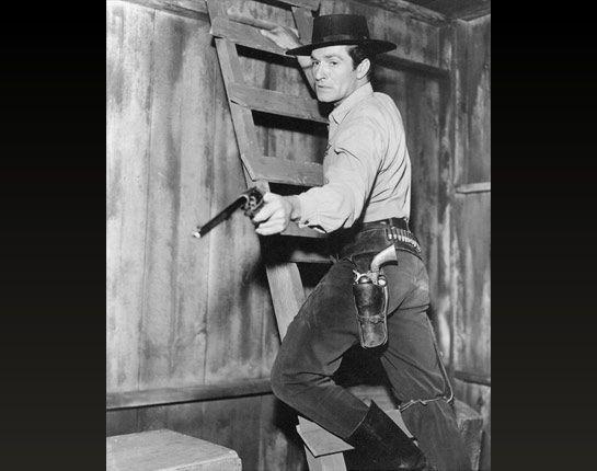 "THE LIFE AND LEGEND OF WYATT EARP (ABC-TV) - Lawman Wyatt Earp (Hugh O'Brian) aims a long-barreled pistol known as  the ""Buntline Special"""