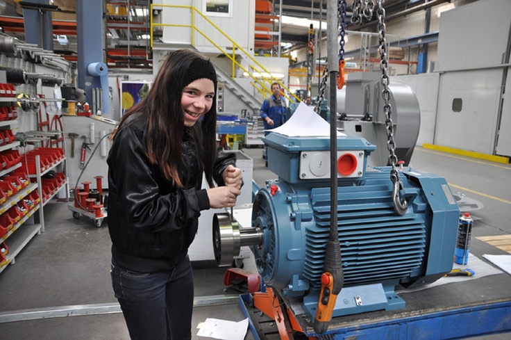 Young women in manufacturing