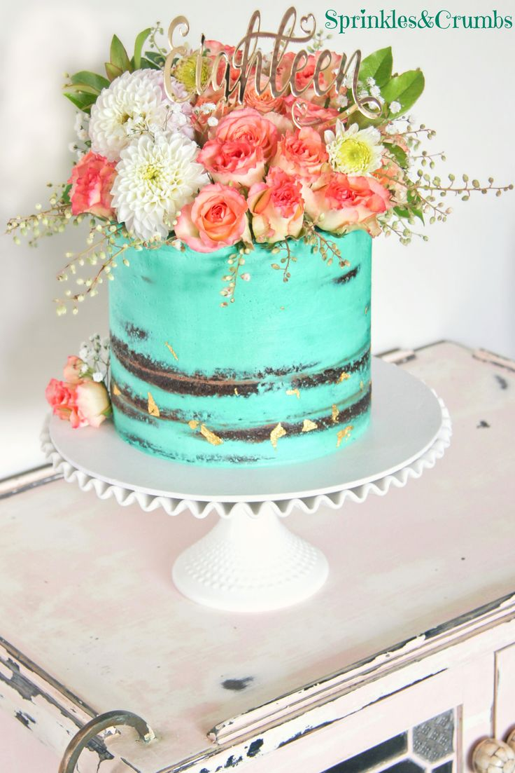 semi naked teal cake with fresh flowers