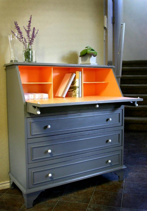 I love this! With the two tone colors and the fold out top - I am now on the hunt for this dresser.