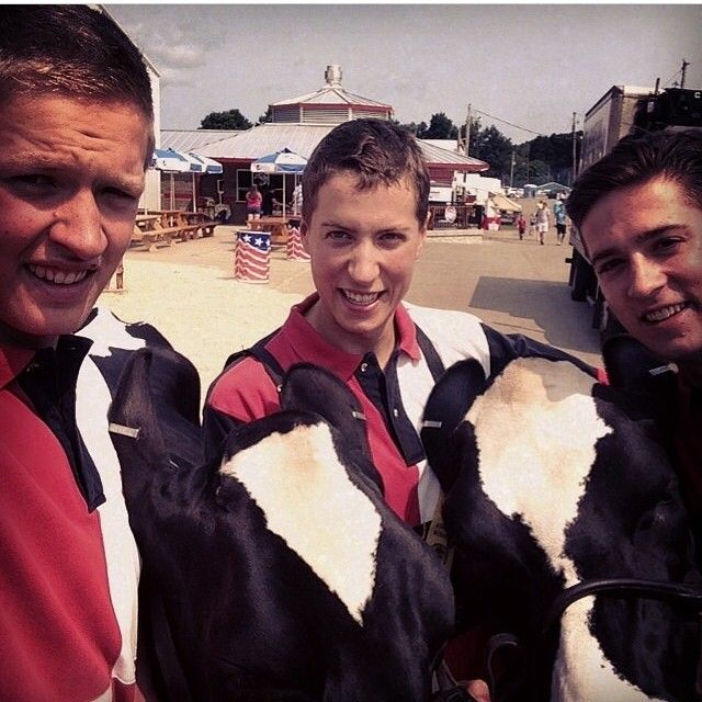 I'm really close to my family even though we live thousands of miles apart though we stay in touch by iMessage and Facetime and we try to all get together twice a year (Christmas and the summer). Here are my brothers and I this summer at The Warren County Fair showing our family's Holstein Fresians.