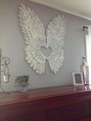 Angel wings made from pieces of cardboard painted white with dabs of light gray. From Country Cupboard on Facebook.