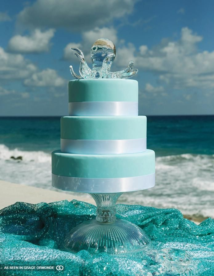 Ever think about a Glass cake topper? Use it after the big day and put in your new home as an accent piece for a coffee table.