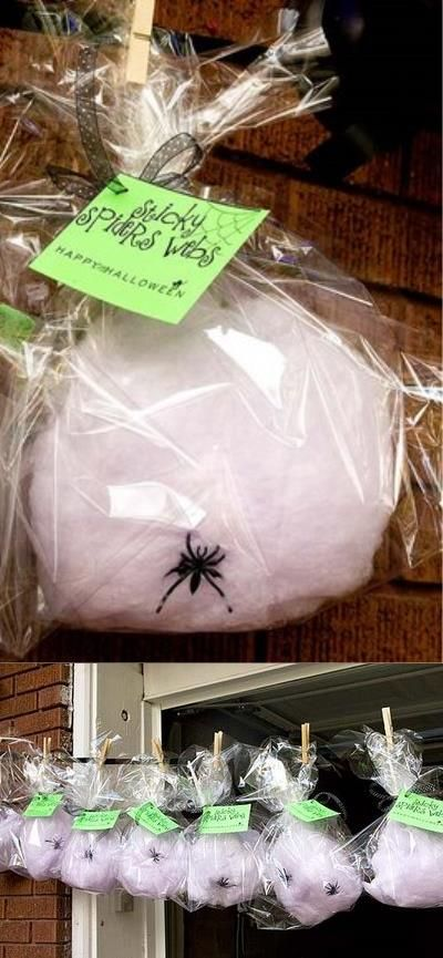 Cotton candy cobwebs hung from the house for trick-or-treaters to take. Definitely doing this next year.
