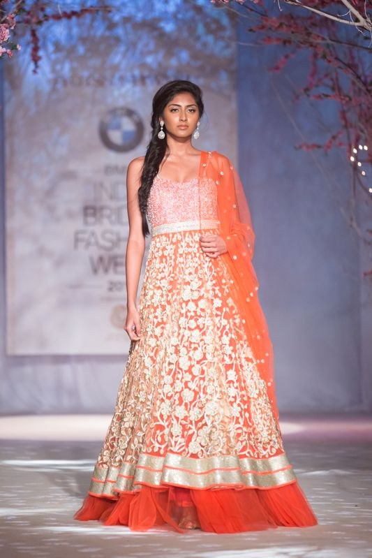 Orange Indian Bridal lehnga gown by Jyotsna Tiwari. More here: http://www.indianweddingsite.com/bmw-india-bridal-fashion-week-ibfw-2014-jyotsna-tiwari/