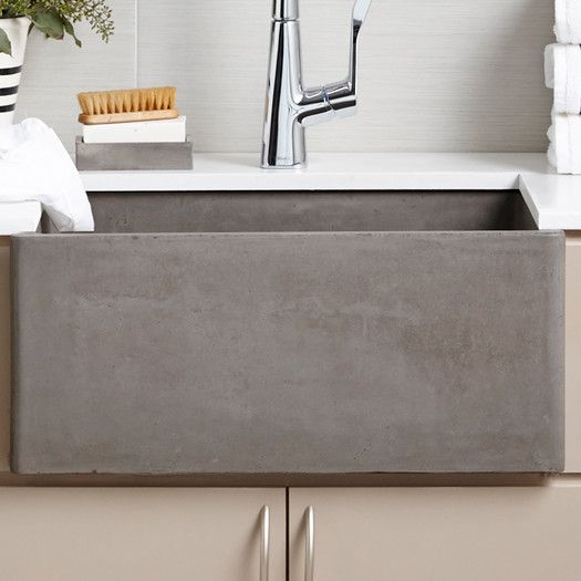 Features: -Farmhouse collection. -Great size for a utility sink or laundry sink. -40% Lighter than traditional concrete and scratch. -UPC/cUPC compliant. -Stain resistant. -Faucet not included.