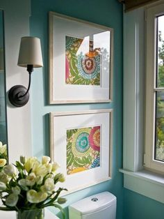 Framing fabric or scrapbook papers as art. I'm thinking great idea in my craft room :)                                                                                                                                                                                 More