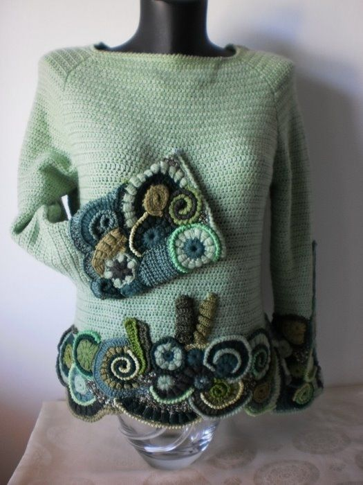 Edging a top with free form crochet to increase the length of of short top.