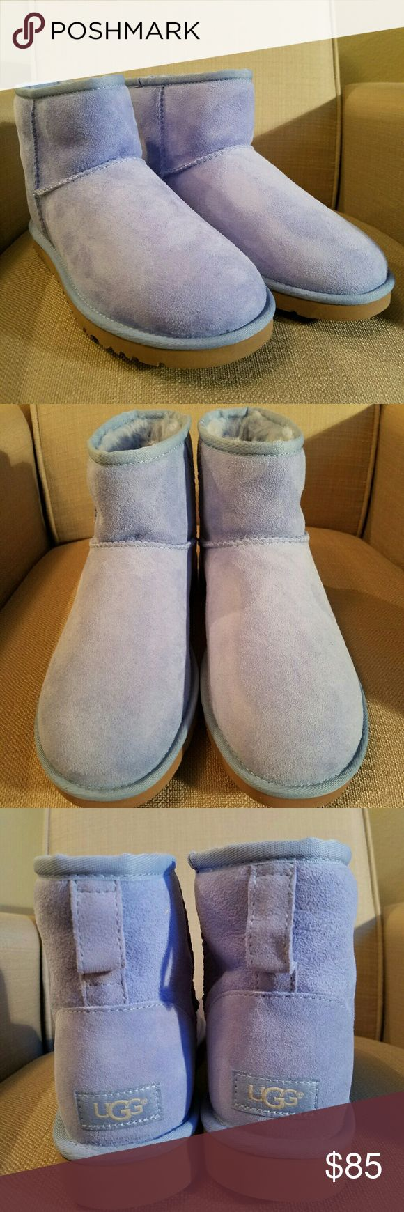 Baby blue UGG Australia boot mini UGG Classic Mini Women's Twinface Sheepskin Classic Boots in Multi. : Ugg Boots for Women - Classic Mini Boots by UGG Australia. One of our most beloved silhouettes, the Classic Mini is an icon of casual style. This boot delivers signature UGG comfort with luxurious Twinface sheepskin, a plush wool insole, and a lightweight, flexible outsole.  Comes in Original UGG box !  COLOR BABY BLUE .  Sorry about some of photos off on the color a little due to…