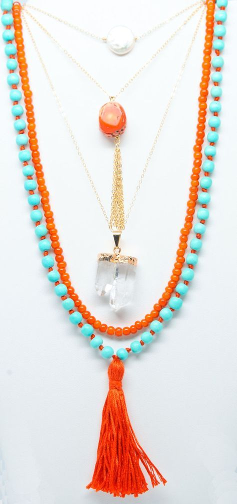 Spring and Summer pop of color - multi strand necklace with aqua and orange beads, clear quartz crystal, and orange tassel