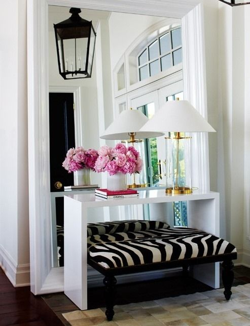 love this whole set up: console, bench, flowers, lamp, books