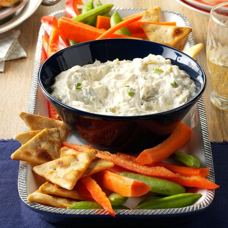 Slow Cooker Crab & Green Onion Dip Recipe -This creamy dip reminds me of my dad, who took us crabbing as kids. Our fingers were tired after those excursions, but eating the fresh crab was worth it. —Nancy Zimmerman, Cape May Court House, NJ