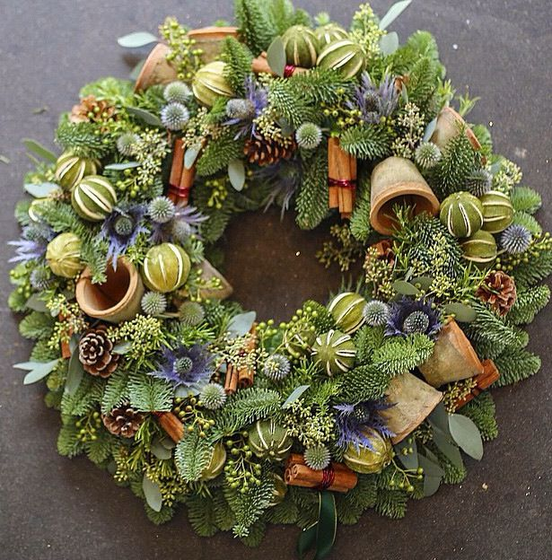 It looks like little dried limes on this beautiful wreath.