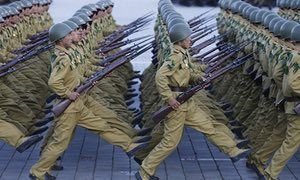 North Korean soldiers march during a mass military parade in Pyongyang. China has warned the US and Kim Jong-un's regime are heading toward a crisis.
