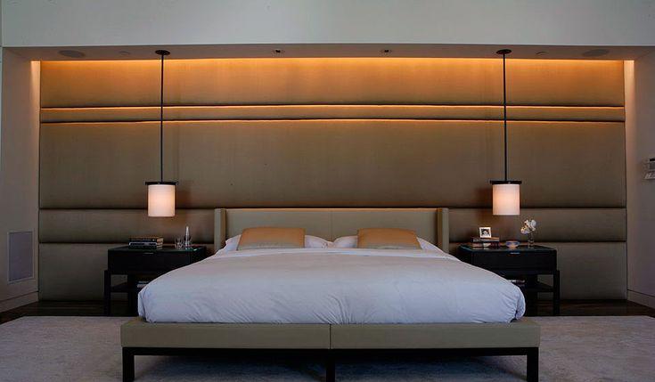 parede almofadada no mesmo tecido da cabeceira da cama. mlkstudio | Brentwood