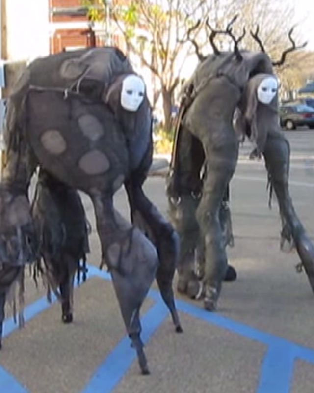 "These intriguing four-legged ""stilt spirit"" costumes were designed by  Melissa Irwin and her husband, Garen. They were inspired The Dark Crystal  and Hayao Miyazaki's spirit characters.   If you like what you see, you can buy instructions on how to make your own  at Melissa's Etsy store here for $10. Of course, you can save yourself $10  and try to wing it by doing it yourself.  The costumes are incredibly creepy, and that's what I love about them. They  also kind of remind me of The ..."