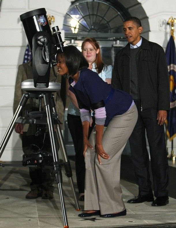 """apsies: """"President Obama watches first lady Michelle Obama look through a telescope during an event to look at the stars with local middle school students and astronomers from across the country on the South Lawn at the White House, October 7, 2009...."""