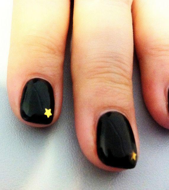 black & gold star nails