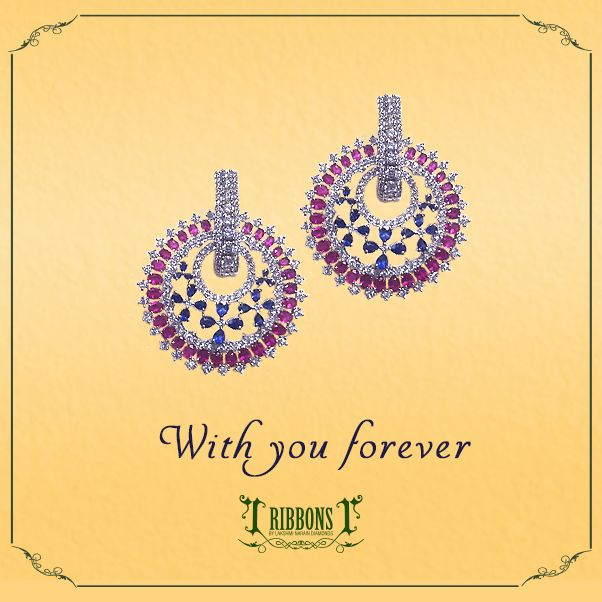 A ring of rubies encircling a floral pattern of sapphires, all highlighted in diamonds make for a tasteful pair of stud earrings! Product Code: RE004  #Earring #Earing #Wedding #Diamond #Ruby #Sapphire #Trust #RibbonsJewellery #Jewelry #Jewels #Delhi #NewDelhi #Jewelers #RibbonsJewellery #Forever