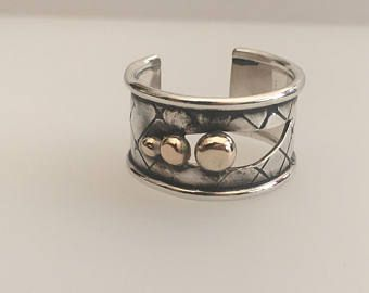 Industrial art ring in sterling silver with gold.