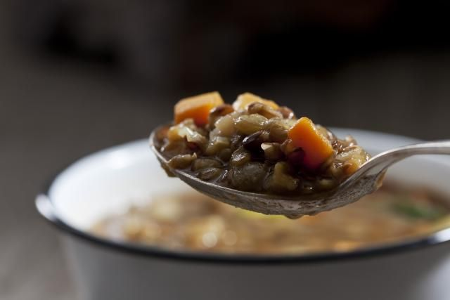 This classic lentil soup recipe is flavored with a ham bone or large ham hock and onions and celery. This lentil soup is a quick and easy preparation.