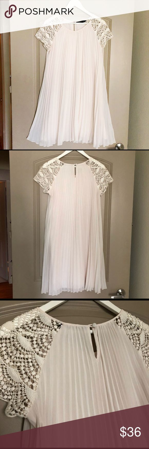 Zara accordion pleated mini dress Gorgeous semi sheer cream dress with crochet short sleeves & Trapeze swing silhouette. Fully lined. Pair with nude seamless bra & thong.  PERFECT FOR GRADUATION OR WEDDING!  Size Medium. Fits size 4-10.  Dry clean. Zara Dresses Mini