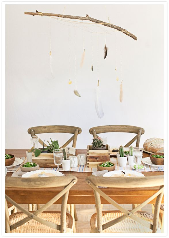 Lovely space an fun DIY idea: a feather mobile