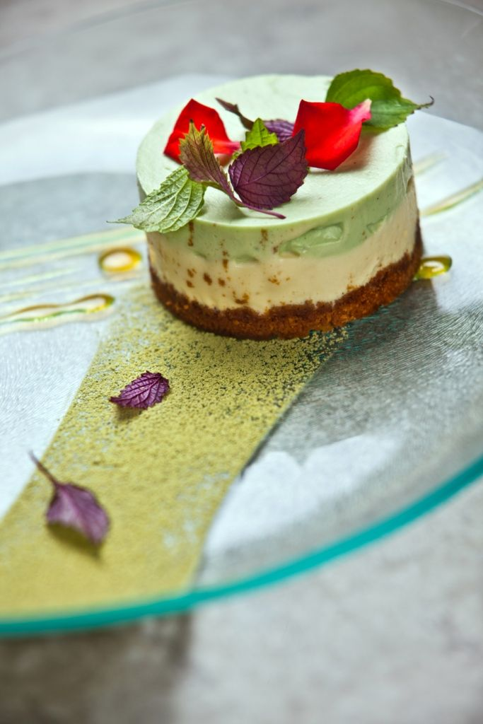 Yuzu matcha cheesecake served with maracuja sauce