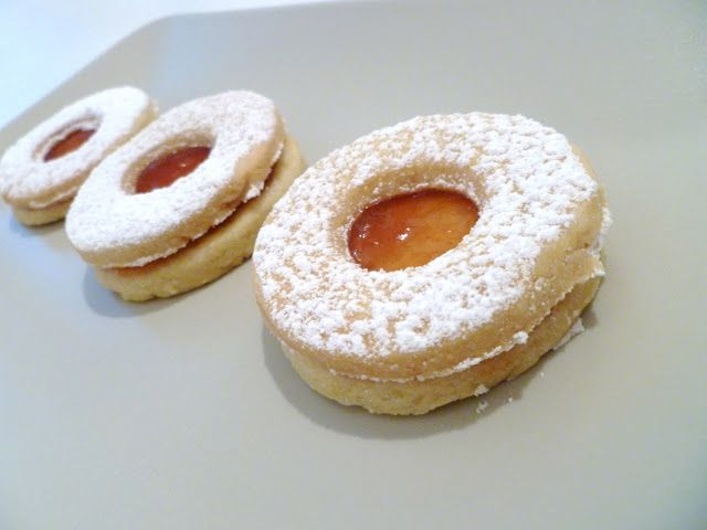 Occhi di Bue cookies- taste of a sugar cookie with the sandiness of a shortbread- filled with apricot jam (the best) OR nutella