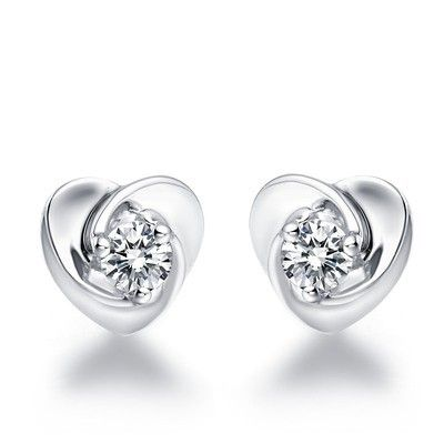 Heart studded with diamonds showcase your love. The beautiful Heart shape diamond earrings feature massive 3/4 carat Round cut diamonds and they are set on 18k White Gold. An instant family heirloom, give her a gift that she would cherish for the time to come