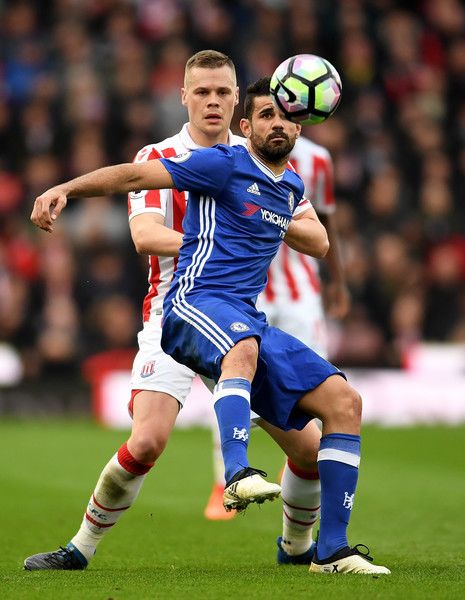 Ryan Shawcross Photos Photos - Ryan Shawcross of Stoke City (L) puts pressure on Diego Costa of Chelsea (R) during the Premier League match between Stoke City and Chelsea at Bet365 Stadium on March 18, 2017 in Stoke on Trent, England. - Stoke City v Chelsea - Premier League