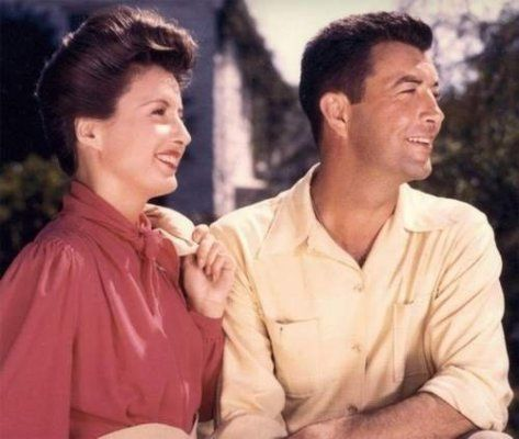 Barbara Stanwyck & husband Robert Taylor on a sunny day (love this shot).