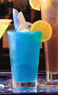Planet Hollywood Blue Lagoon (1¼ oz. Absolut Vodka ¾ oz. Blue Curacao Equal Parts Pineapple Juice and Pink Lemonade Lemon Wheel)