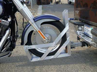 Motorcycle towing cradles, such as the Ansell Tow Dolly, allow you to tow your bike without a trailer.