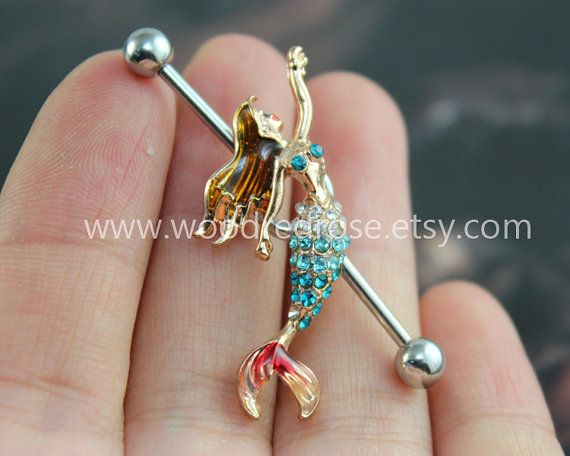 arghh one year until i can get industrial peircing...unless mum lied and she wont let me...im 15 ill trt convice her for this year.Mermaid Industrial Barbell Ear Jewelry Double by woodredrose