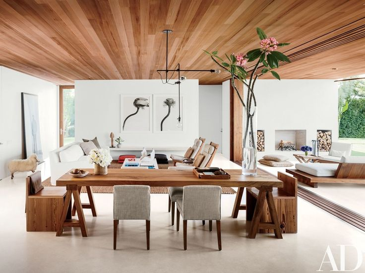 The dining area is appointed with an oak table custom made by Lars Bolander and pine benches by 1100 Architect | archdigest.com