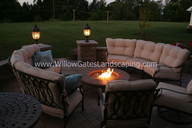 Paver Patio With Comfortable Seating Around Gas Fire Pit