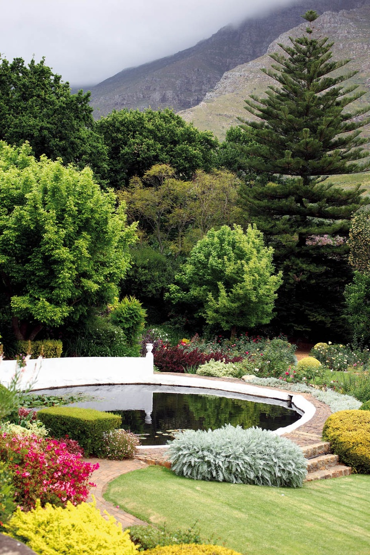 The view of the garden from the stoep of the manor house, with Jonkershoek mountains in the background.
