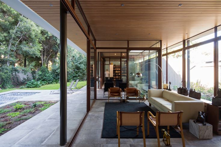Image 1 of 25 from gallery of The House and the Trees  / Iglesis Arquitectos. Photograph by Nico Saieh