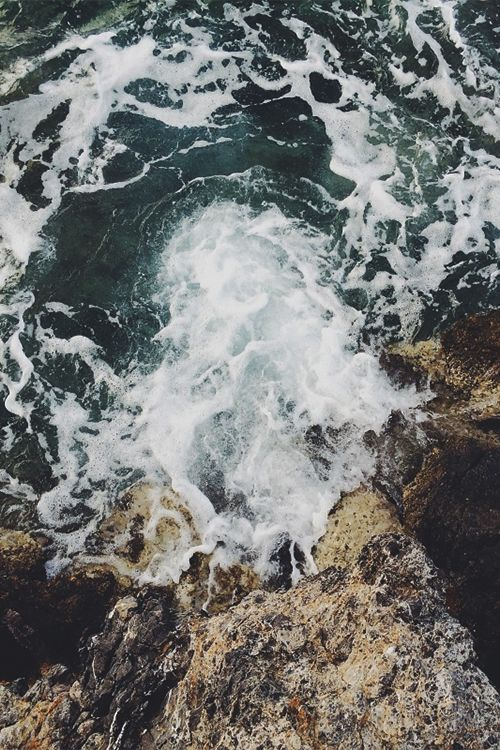Beautiful waves crashing against rocks.