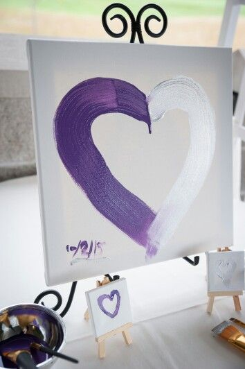 Unity painting for wedding instead of a unity candle. The mothers a alked down and each painted a small heart representing where we came from and then my husband and I painted each side of the heart durring our ceremony representing two of us becoming one family. #unitypainting #wedding #amandabriscophotography