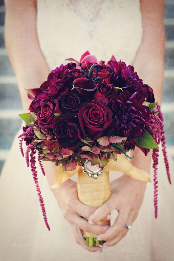 Beautiful burgundy bouquet with gold accents Perfect for a Christmas or winter wedding.