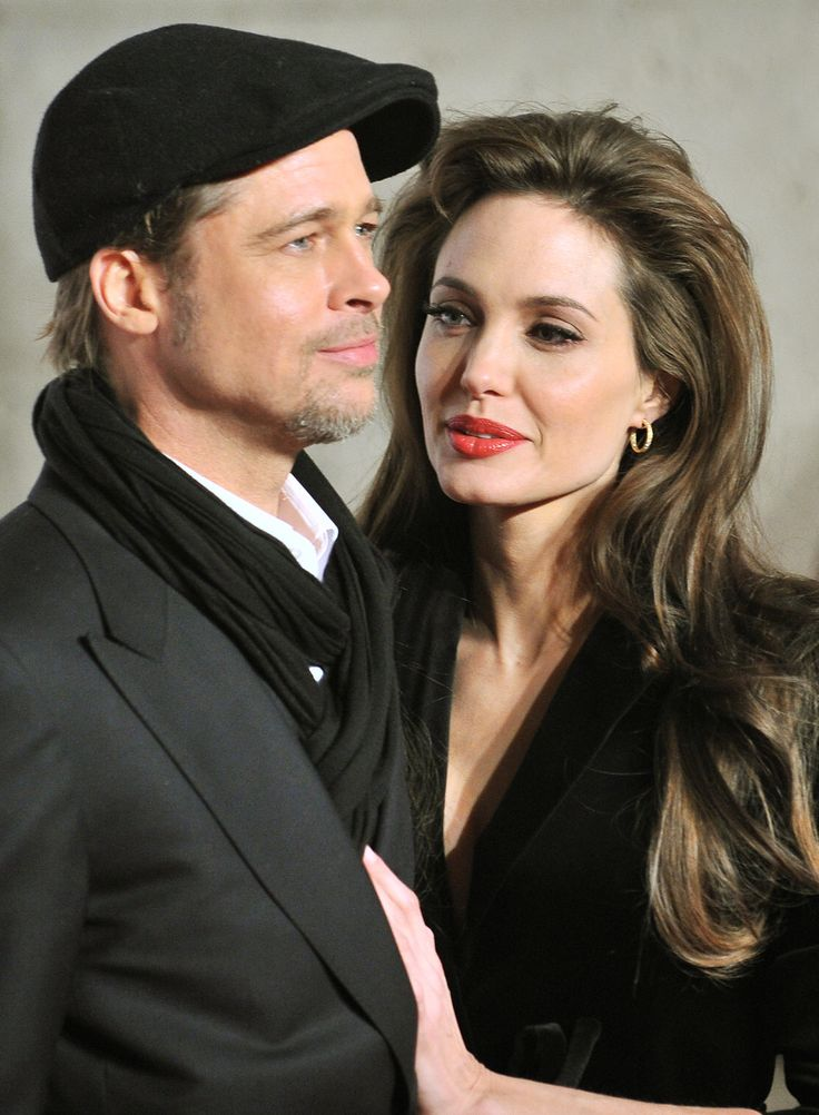 US actors Brad Pitt and Angelina Jolie pose upon arrival for the premiere of Jolie's latest movie ''The Tourist'' by German director Florian Henckel von Donnersmarck, on December 15, 2010, in Rome. AFP PHOTO / ALBERTO PIZZOLI (Photo credit should read ALBERTO PIZZOLI/AFP/Getty Images) via @AOL_Lifestyle Read more: http://www.aol.com/article/entertainment/2016/09/26/jennifer-aniston-evil-eye-necklace-brangelina-divorce/21479570/?a_dgi=aolshare_pinterest#fullscreen