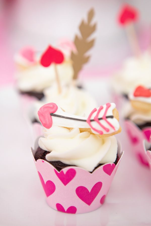 Arrow topped cupcakes at a Valentine's Day party! See more party planning ideas at CatchMyParty.com!