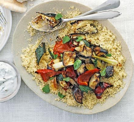 Oven bake courgettes, peppers and aubergines, add a kick of harissa and serve with couscous salad and cool yoghurt sauce